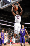 Los Angeles Lakers v New Jersey Nets: Derrick Favors and Luke Walton Photographic Print by Andrew Bernstein
