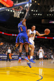 New York Knicks v Golden State Warriors: Dan Gadzuric Photographic Print by Rocky Widner