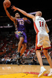 Phoenix Suns v Miami Heat: Grant Hill and Zydrunas Ilgauskas Photographic Print by Andrew Bernstein