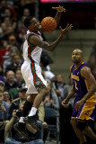 Los Angeles Lakers v Milwaukee Bucks: Brandon Jennings and Derek Fisher Photographic Print by Jonathan Daniel