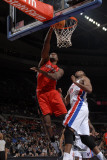 Toronto Raptors v Detroit Pistons: Joey Dorsey and Greg Monroe Photographic Print by Allen Einstein
