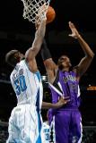 Sacramento Kings v New Orleans Hornets: Jason Thompson and Emeka Okafor Photographic Print by Chris Graythen