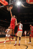 Houston Rockets v Toronto Raptors: Luis Scola and Amir Johnson Photographic Print by Ron Turenne