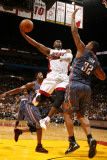 Charlotte Bobcats v Miami Heat: Dwyane Wade and Boris Diaw Photographic Print by Issac Baldizon