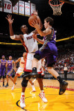 Phoenix Suns v Miami Heat: Goran Dragic and Chris Bosh Photographic Print by Andrew Bernstein