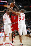 Chicago Bulls v Houston Rockets: Luol Deng, Brad Miller and Shane Battier Photographic Print by Bill Baptist