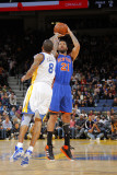 New York Knicks v Golden State Warriors: Wilson Chandler and Monta Ellis Photographic Print by Rocky Widner