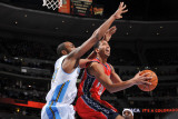 New Jersey Nets v Denver Nuggets: Devin Harris and Melvin Ely Photographic Print by Garrett Ellwood