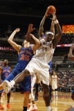 New York Knicks v Charlotte Bobcats: Kwame Brown and Timofey Mozgov Photographic Print by Kent Smith