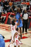 Oklahoma City Thunder v Houston Rockets: Serge Ibaka and Luis Scola Photographic Print by Bill Baptist