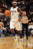 New York Knicks v Denver Nuggets: Ty Lawson Photographic Print by Doug Pensinger