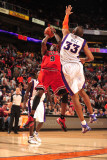 Chicago Bulls v Phoenix Suns: Luol Deng and Grant Hill Photographic Print by Barry Gossage