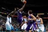 Sacramento Kings v New Orleans Hornets: Tyreke Evans and Emeka Okafor Photographic Print by Chris Graythen