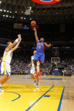 New York Knicks v Golden State Warriors: Raymond Felton and Stephen Curry Photographic Print by Rocky Widner