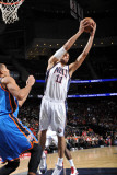 Oklahoma City Thunder v New Jersey Nets: Brook Lopez Photographic Print by Jesse D. Garrabrant