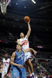Washington Wizards v Detroit Pistons: Tayshaun Prince and JaVale McGee Photographic Print by Allen Einstein