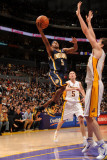 Indiana Pacers v Los Angeles Lakers: T.J. Ford and Pau Gasol Photographic Print by Andrew Bernstein