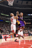 Los Angeles Lakers v Chicago Bulls: Kobe Bryant and Taj Gibson Photographic Print by Andrew Bernstein