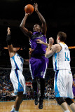 Sacramento Kings v New Orleans Hornets: Samuel Dalembert, David West and Jason Smith Photographic Print by Chris Graythen