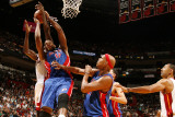 Detroit Pistons v Miami Heat: Greg Monroe and Joel Anthony Photographic Print by Issac Baldizon