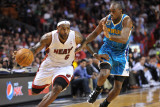 New Orleans Hornets v Miami Heat: LeBron James and Quinxy Pondexter Photographic Print by James Riley