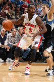 Detroit Pistons v Minnesota Timberwolves: Rodney Stuckey and Luke Ridnour Photographic Print by David Sherman