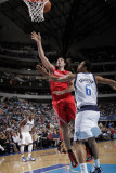 Houston Rockets v Dallas Mavericks: Tyson Chandler and Luis Scola Photographic Print by Glenn James