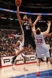 San Antonio Spurs v Los Angeles Clippers: Tim Duncan and Blake Griffin Photographic Print by Andrew Bernstein