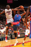 Detroit Pistons v Miami Heat: Greg Monroe and Joel Anthony Photographic Print by Victor Baldizon