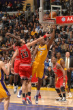Chicago Bulls v Los Angeles Lakers: Lamar Odom and Joakim Noah Photographic Print by Andrew Bernstein