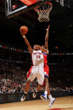 Philadelphia 76ers v Toronto Raptors: Leandro Barbosa and Thaddeus Young Photographic Print by Ron Turenne