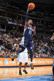 Memphis Grizzlies v Denver Nuggets: Mike Conley Photographic Print by Garrett Ellwood