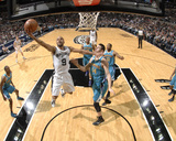 New Orleans Hornets v San Antonio Spurs: Tony Parker and Jason Smith Photographic Print by D. Clarke Evans