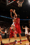 Houston Rockets v Toronto Raptors: DeMar DeRozan and Brad Miller Photographic Print by Ron Turenne