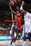 Chicago Bulls v Denver Nuggets: Luol Deng and Nene Photographic Print by Garrett Ellwood