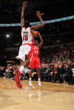 Philadelphia 76ers v Toronto Raptors: Louis Williams and Amir Johnson Photographic Print by Ron Turenne