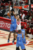 Oklahoma City Thunder v Houston Rockets: Serge Ibaka and Luis Scola Photographic Print by Bill Baptist
