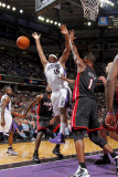 Miami Heat v Sacramento Kings: DeMarcus Cousins and Chris Bosh Photographic Print by Rocky Widner
