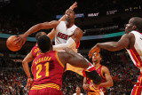 Cleveland Cavaliers v Miami Heat: Dwyane Wade and J.J. Hickson Photographic Print by Victor Baldizon