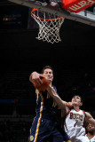 Indiana Pacers v Milwaukee Bucks: Jeff Foster and Ersan Ilyasova Photographic Print by Gary Dineen