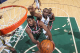 Milwaukee Bucks v Utah Jazz: Al Jefferson and John Salmons Photographic Print by Melissa Majchrzak