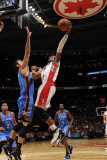 Oklahoma City Thunder v Toronto Raptors: Nenad Kristic and Leandro Barbosa Photographic Print by Ron Turenne