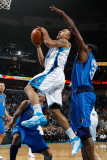 Dallas Mavericks v New Orleans Hornets: Jerryd Bayless and Brendan Haywood Photographic Print by Chris Graythen