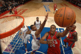 New Jersey Nets v Los Angeles Clippers: Derrick Favors and Jarron Collins Photographic Print by Noah Graham