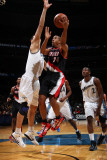 Portland Trail Blazers v Washington Wizards: Andre Miller and Yi Jianlian Photographic Print by Ned Dishman