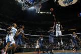 Charlotte Bobcats v New Orleans Hornets: Emeka Okafor and Nazr Mohammed Photographic Print by Layne Murdoch