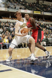 Toronto Raptors v Indiana Pacers: Tyler Hansbrough and Joey Dorsey Photographic Print by Ron Hoskins