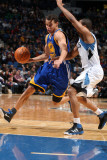 Golden State Warriors v Minnesota Timberwolves: Stephen Curry and Sebastian Telfair Lámina fotográfica por David Sherman