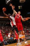 Philadelphia 76ers v Miami Heat: Dwyaen Wade and Spencer Hawes Photographic Print by Victor Baldizon
