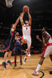 Atlanta Hawks v Toronto Raptors: Linas Kleiza and Zaza Pachulia Photographic Print by Ron Turenne